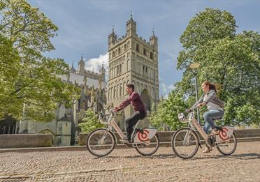 Co-Bikes riding past Cathedral Green (c) Gareth Williams Photography