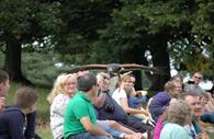People in Powderham Castle gardens