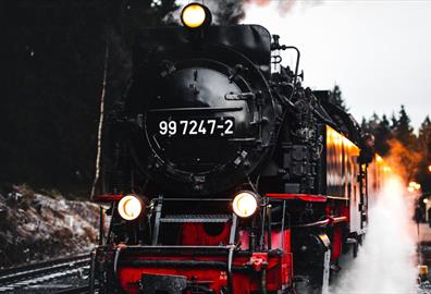 Red and black steam train