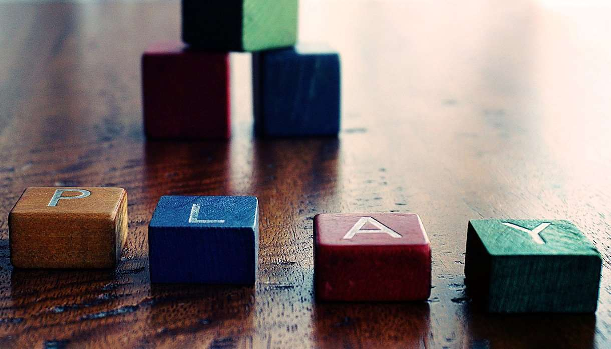 Colourful children's blocks spelling the world play