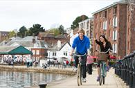 Cycling on Exeter Quayside. Copyright: Tony Cobley