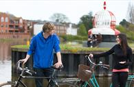 Cycling by the Quay. Copyright: Tony Cobley