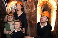 Family exploring the underground passages