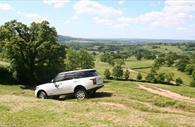 Range Rover Descending the field