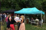 Visitors enjoying a drink from Exeter Street Food Market Southernhay Gardens