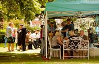 Visitors sat at Exeter Street Food Market Exeter Southernhay Gardens