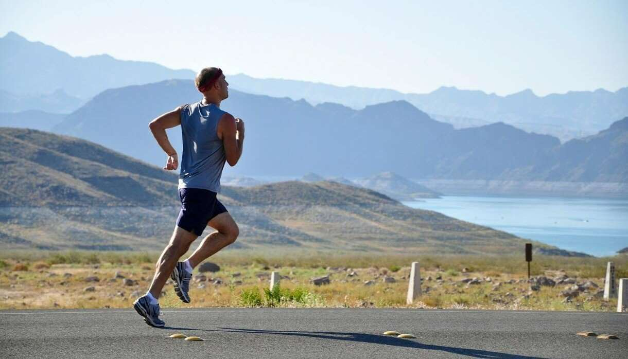 Person running on a scenic road