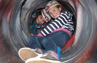 Children in a tunnel at Haven Banks