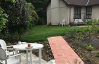 Whispers Homestay garden area       Validation      •