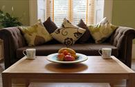 Living area with teas and fruit bowl