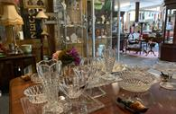 Room filled with antiques and collectables, glass