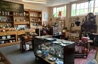 Room filled with antiques and collectables, china plates
