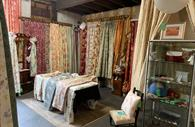Room filled with antiques and collectables, curtains