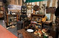 Room filled with antiques and collectables, books and ornaments