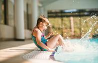 Child splashing in Cofton Pool