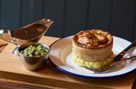 Pie, mash with peas and gravy