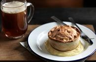 Pie and mash with drink
