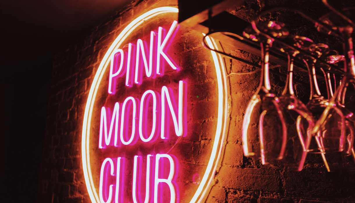 Pink Moon Club sign