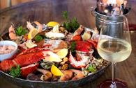 Seafood platter and glass of wine