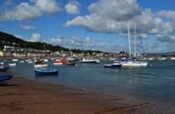 Teignmouth River Beach with boats all along it