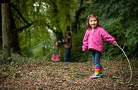 Child explores the woods at The Donkey Sanctuary