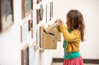 Child explores engaging exhibits in the Nature Centre