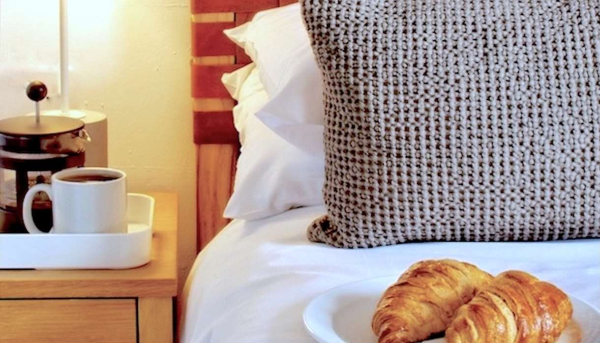 Bedside table - coffee and croissants