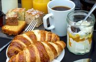 Continental breakfast - croissants, yoghurt, coffee and cake