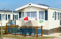 Welcome Family Holiday Park: angled image of a lodge