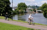 People cycling along Exeter Canal
