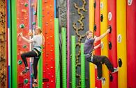 Two people using Clip 'n Climb
