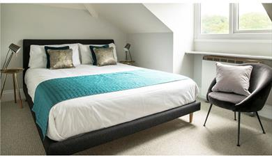 Master bedroom on top floor with King bed and en suite toilet & basin