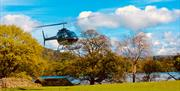 Arrive at Waternook & The Great Barn by helicopter