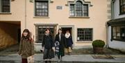 Happy visitors at the Beatrix Potter Gallery, Hawkshead