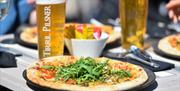 Pizza and pints in the beer garden.