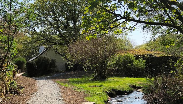 Pont Faen has been newly renovated and is tucked away in a secluded location with a stream to the front and private lake to the rear. Single storey an