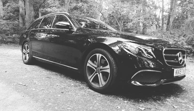Black and White image of stunning Black E-Class Estate on a 19 plate.