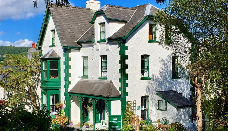 The exterior of the building Crafnant House - a bed and breakfast on the main road in the village of Trefriw in Wales