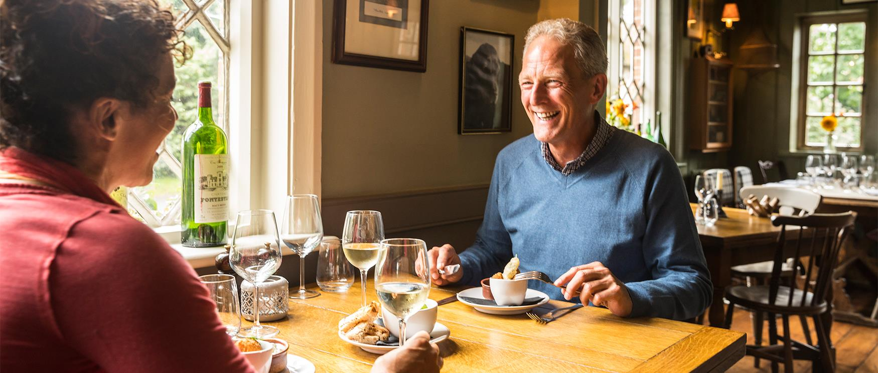 Couple Dining in Country Pub