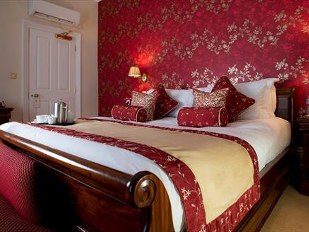 Bedroom at The Clarence Boutique Hotel