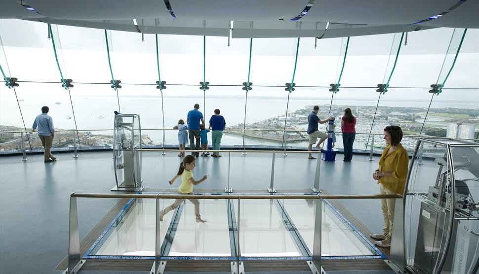 People enjoying the viewing deck at the Spinnaker Tower