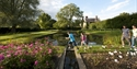 Visitors by the pond, Bateman's, East Sussex. ©National Trust Images John Millar