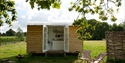 Shepherd's Hut accommodation at Oxney Organic Vineyard in Beckley, near Rye, East Sussex.