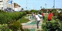 Playing on the Adventure Golf Course in Hastings East Sussex
