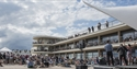 Exterior shot of the De La Warr Pavilion with large audience listening to music on the bandstand in Bexhill East Sussex