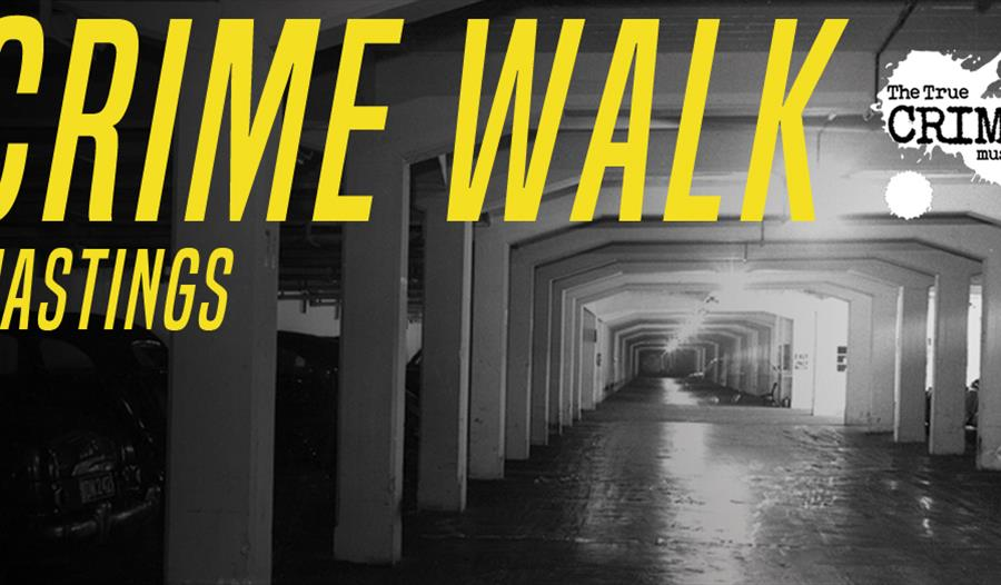 A poster for the Crime Walk event by the True Crime Museum Hastings. a black and white photograph of an underground carpark, with yellow lettering ove