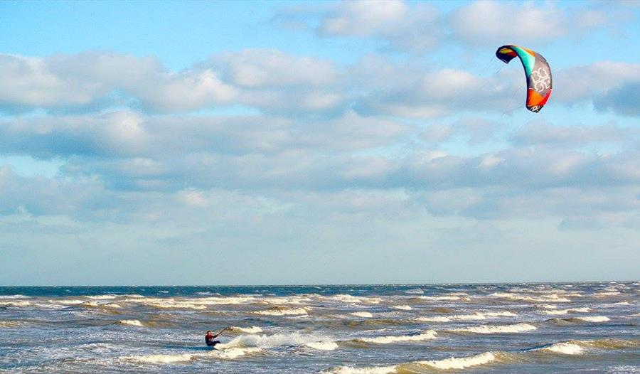 Kite surfer in the sea at Camber Sands, East Sussex