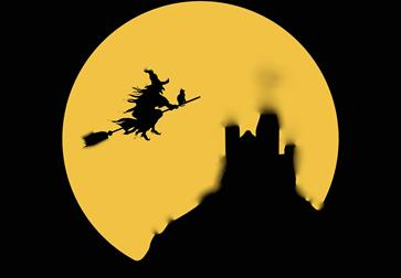 an illustration of a large yellow moon and silhouette of a witch on a broom stick.