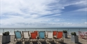 Deckchairs on the roof of the De La Warr Pavilion looking out to the sea in Bexhill East Sussex
