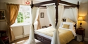 Four poster bed at Claverton Country House Hotel in Westfield, near Battle, East Sussex